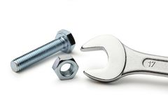 Screw bolts and nuts. Screw bolt, nut and metallic wrench Royalty Free Stock Photos