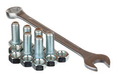 Screw bolts, nuts and spanner Stock Image