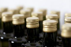 Screw caps on glass bottles. Stock Photos