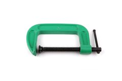 Clamp. Green painted clamp isolated over white background royalty free stock image