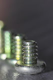 Screw close up. Grey background.Extreme close up Royalty Free Stock Photography