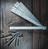 Screw and construction meter Royalty Free Stock Images