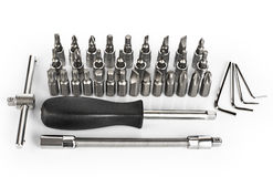 Screw driver and bits set  on white background. Stock Image