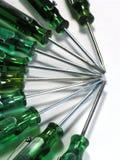 Driver Macro. OLYMPUS DIGITAL CAMERA Multiple small green screwdrivers royalty free stock photography