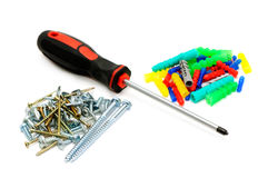 Screw-driver and screws Royalty Free Stock Photos