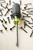 Screw driver and screws Stock Photos