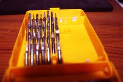 Screw Driver Set on yellow Box.Interchangeable screwdriver set with different types of metal steel heads and bits.set of tools