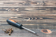 Screw driver on wooden matting Royalty Free Stock Photo