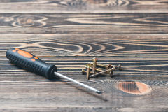 Screw driver on wooden matting Royalty Free Stock Photography
