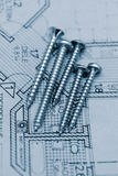 Screw on floorplan. Some screws on a colored floorplan Royalty Free Stock Photos