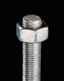 Screw isolated on black background. Stock Photo