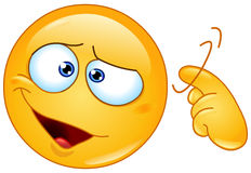 Screw loose emoticon. Emoticon showing a screw loose sign by twisting his finger into temple. You are crazy sign Royalty Free Stock Photography