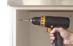 Screw machine. Construction concept with screwdriver and screw closup Stock Photos