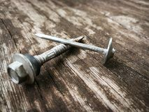 Screw nail. On the Wood floorn Royalty Free Stock Images