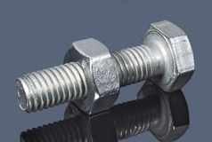 Screw and nut on a dark background. Closeup Royalty Free Stock Photo
