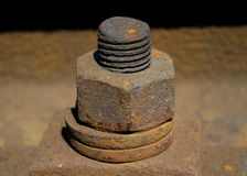 Screw and nut full of rust- on the rail train stock photo