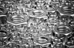 Screw nuts. Assorted screw nuts background, selective focus Stock Photography