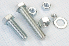 Screw and Nuts on  graph paper background Stock Images