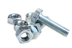 Screw and nuts. One of metal screw and nuts isolated on white background Royalty Free Stock Photography