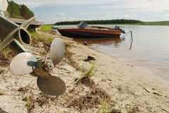 Screw propeller, motor boats on the shore Stock Photos