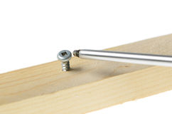 Screw and Screwdriver. Robertson screwdriver screwing into wood, isolated on white background Stock Photos