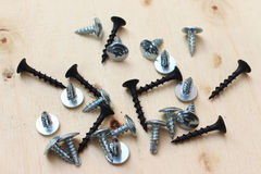 Screw steel on wooden desk Stock Photography