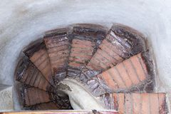 Screw stone staircase in the Clock Tower in the castle of old city.  Sighisoara city in Romania Royalty Free Stock Photography