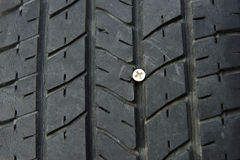 Screw in tire. Royalty Free Stock Photography