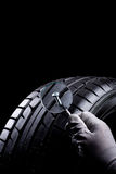 In tire. Flat tire with a which is enlarged by a magnifying glass stock images