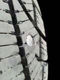 In tire. Into rubber tire isolated towards black background stock image