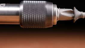 The screw is wearing a bit of electric screwdriver. Macro photography moving camera stock video