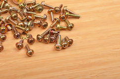 Screw on wooden background. Some screw on a natural wooden background royalty free stock photo