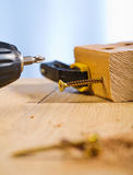 In the wooden plank. With the vise grip on the wooden table stock images