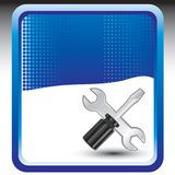 Screwdrive and wrench on blue halftone banner Royalty Free Stock Photography