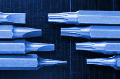 Screwdriver bit set over steel background Royalty Free Stock Photography