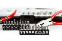 Screwdriver Bit Set on White with pliers Stock Images