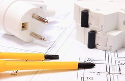 Screwdriver, electric plug and fuse on construction drawing Royalty Free Stock Image