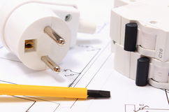 Screwdriver, electric plug and fuse on construction drawing Stock Image
