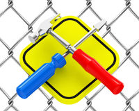 Screwdriver and hammer. 3d generated picture of a screwdriver and a hammer infront of a wire fence Stock Images