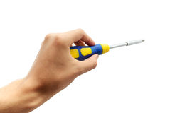 Screwdriver in hand Royalty Free Stock Photography