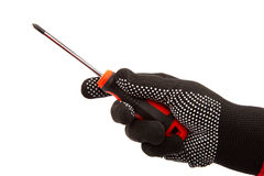 Screwdriver in hand with gloves on white background. Royalty Free Stock Image