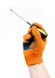 Screwdriver in hand Royalty Free Stock Photo