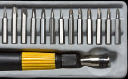 Screwdriver handle and bits Royalty Free Stock Photography
