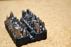 Screwdriver heads. Composition with a few screwdriver heads ,objects used in construction Royalty Free Stock Images