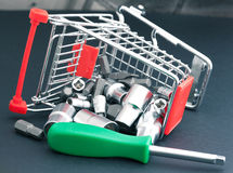 Screwdriver with interchangeable heads in toppled shopping cart Stock Image