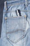 Screwdriver in jean Stock Photo