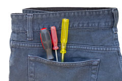 Screwdriver in a jeans pocket Royalty Free Stock Photo