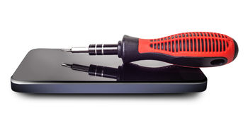 Screwdriver lying on the phone Stock Images