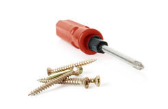 Screwdriver with nails Royalty Free Stock Photo