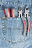 Screwdriver, nippers and pliers in the pocket Royalty Free Stock Image